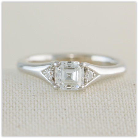 diamond solitaire, with small round brilliant accents