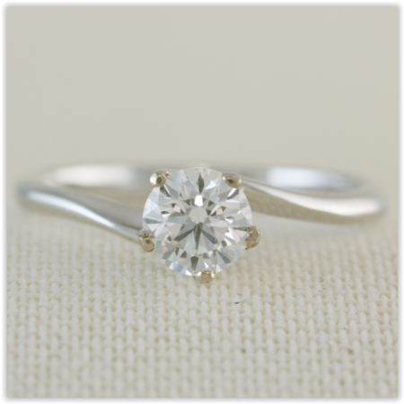 white gold, twisted band solitaire