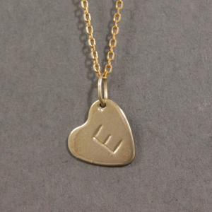 gold heart necklace with initial