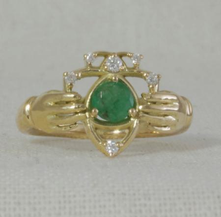 Yellow gold emerald claddagh