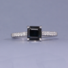 Sapphire solitaire ring with diamond shoulders