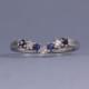 Diamond and sapphire wishbone ring