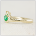 Handmade yellow gold claddagh ring with emerald set centre