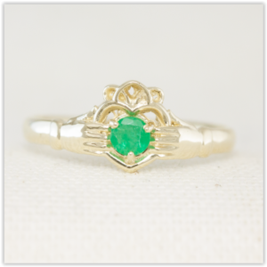 Handmade 9k yellow gold claddagh ring with emerald centre stone