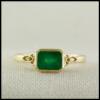 Emerald set Trinity knot celtic ring