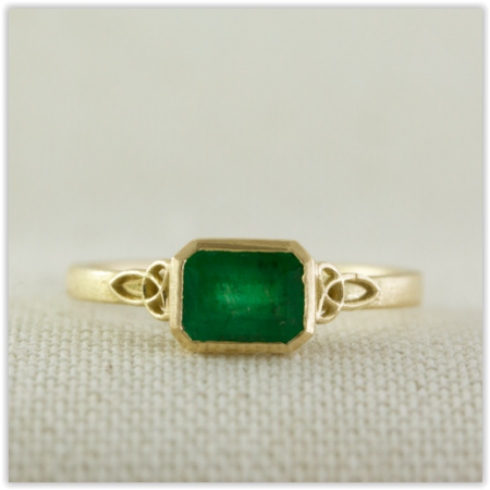 Emerald set Trinity knot celtic ring