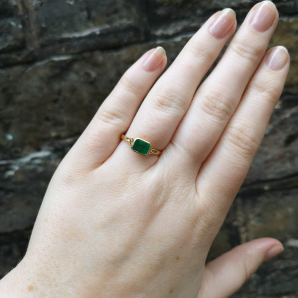 emerald trinity on finger