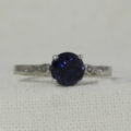 white gold sapphire ring with infinity shoulders