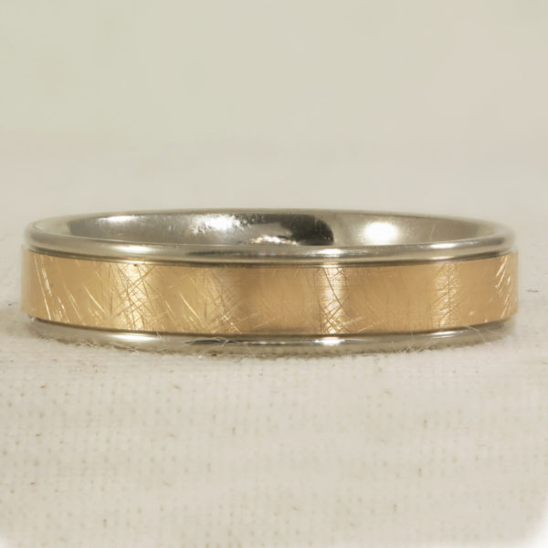 5mm flat band, outer ring is white gold, with rose gold centre. Finished with a scratch effect