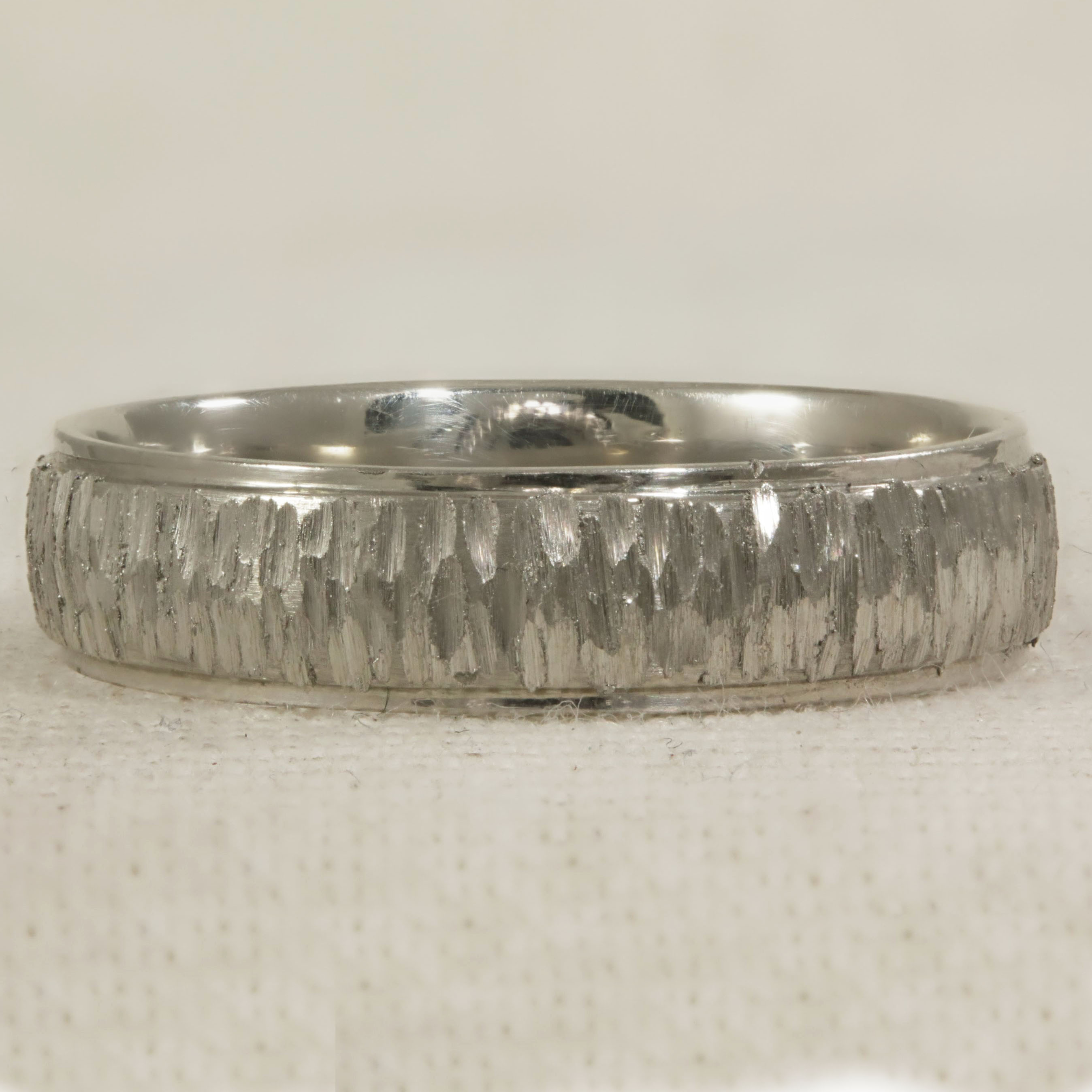 Court Shape band, slightly raised centre with hand engraved bark effect