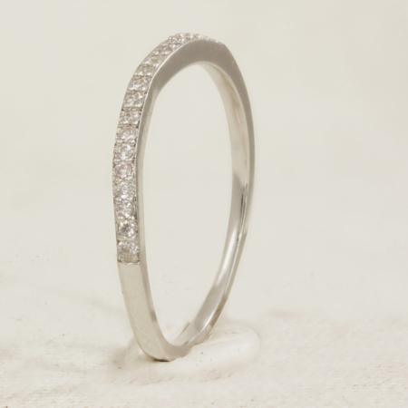 Half set diamond ring with slight curve