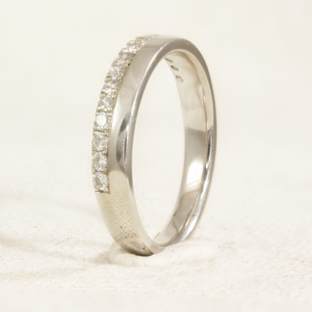 3.5mm ring, 1 half of ring is set with diamonds and the other has a high polish finish