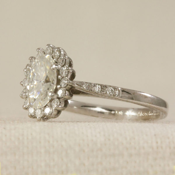 Antique style halo engagement Ring