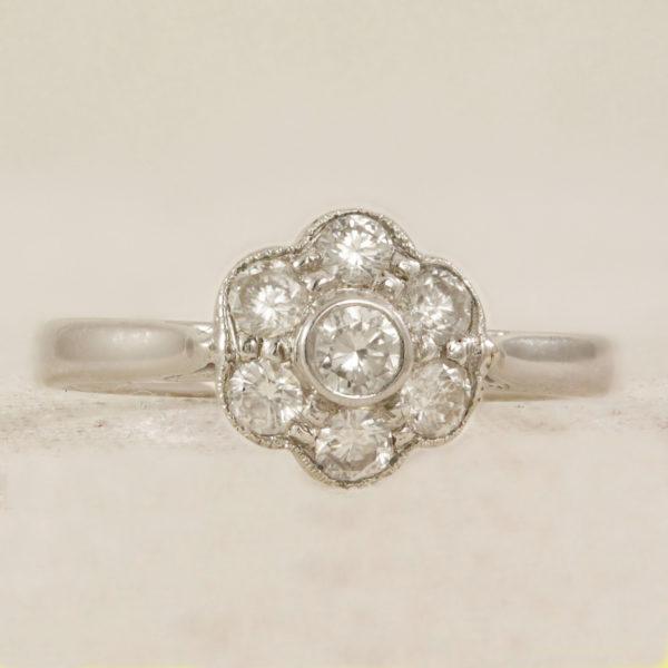 Flower shape cluster engagement ring