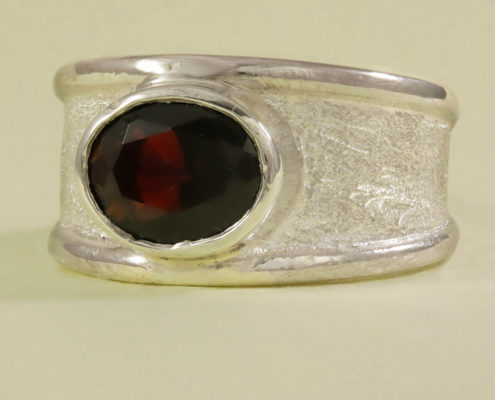 7mm heavy Silver band with oval garnet