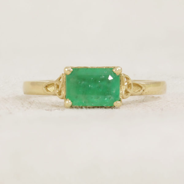 claw set emerald trinity ring