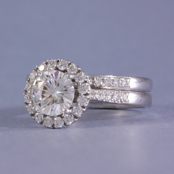Moissanite Halo engagement ring with a matching wedding ring