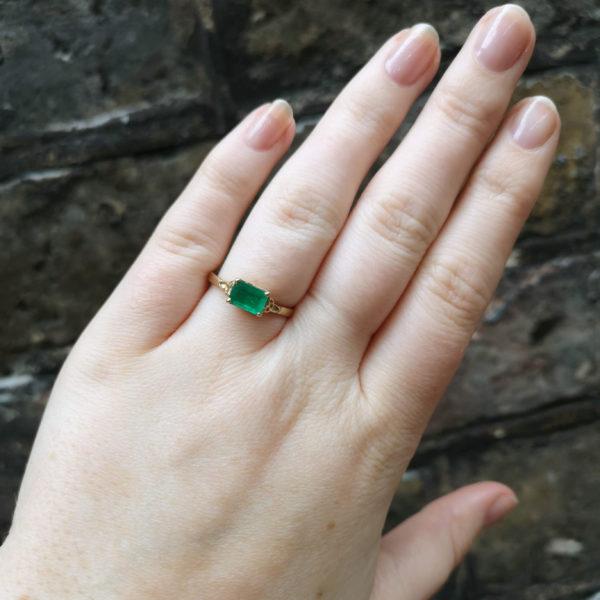 claw set emerald trinity ring