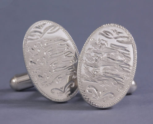 Cufflinks hand engraved with family crest