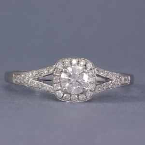 diamond halo engagement ring with a split shoulder band